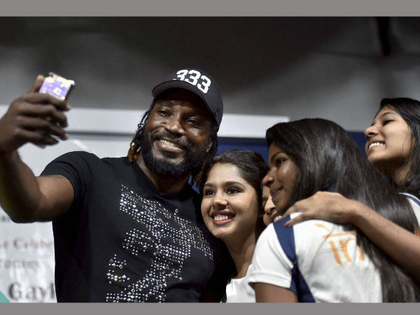 West Indies cricketer Chris Gayle taking a selfie with students during a function at a private college in Chennai