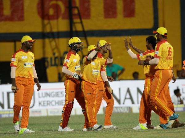 Dindigul Dragons' players celebrate a wicket against VB Thiruvallur Veerans