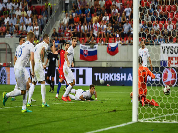 Adam Lallana (red) scores past Slovakian defenders (Image courtesy: England Twitter handle)