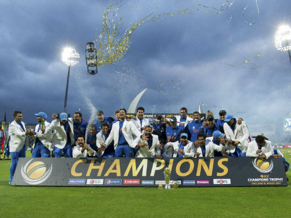 Indian players celebrate their Champions Trophy win in 2013