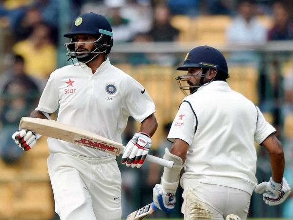 India's Shikhar Dhawan And Murali Vijay Run Between The Wickets During The 1st Day Of 2nd Test Match Between India And South Africa At Chinnaswamy Stadium In Bengaluru.