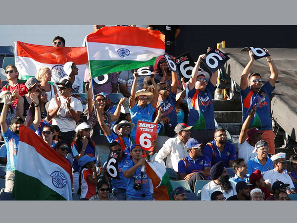 A file picture of Indian fans cheering their team during a match