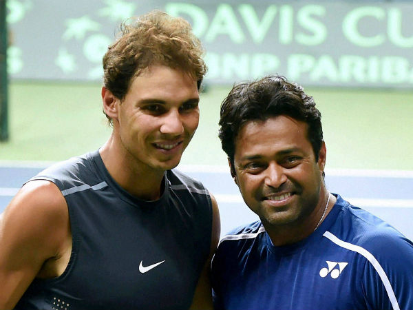 Paes (right) poses with Nadal in New Delhi ahead of India-Spain Davis Cup tie