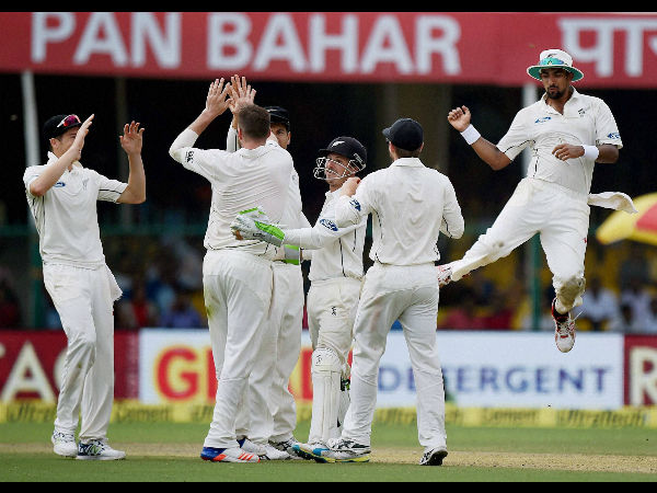 New Zealand players celebrating the wicket of India's Ajinkya Rahane during the first day of first test match at Green Park in Kanpur on Thursday.