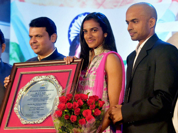 Maharashtra Chief Minister Devendra Fadnavis felicitates Olympic silver medallist shuttler P V Sindhu and her coach Gopichand in Mumbai.