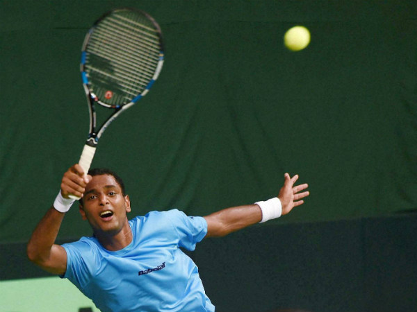 India's Ramkumar Ramanathan returs during the singles match against Spain's Feliciano Lopez in the Davis Cup