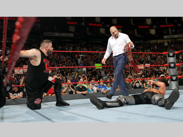 Owens, Triple H, and Rollins on WWE Raw (image courtesy wwe.com)