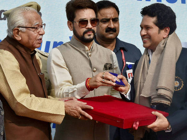 Uttar Pradesh Governor Ram Naik (left) and BCCI President Anurag Thakur (centre) present momentos to former Indian Cricket captain Sachin Tendulkar on the occasion of India's 500th Test match