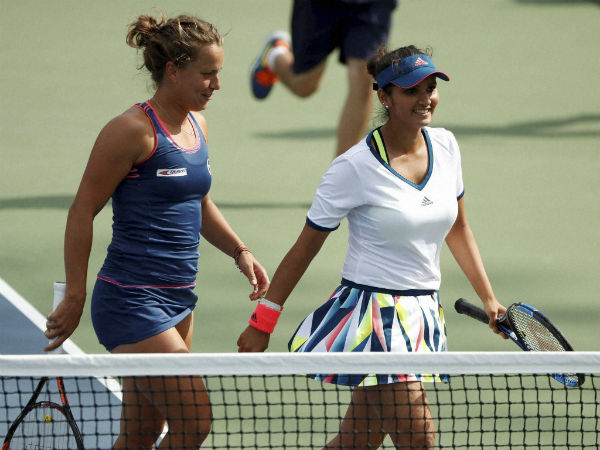 Sania Mirza, right, and doubles partner Barbora Strycova, of the Czech Republic, walk to their bench between games against Nicole Gibbs, of the United States, and Nao Hibino, of Japan, during the third round of the U.S. Open tennis tournament.