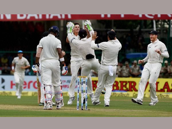 New Zealand seamer Mitchell Santner celebrates with his teammates after dismissing K.L. Rahul on the opening day of the first Test match at Green Park in Kanpur on Thursday.
