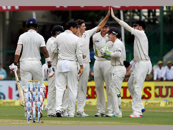 Mitchell Santner celebrates with his teammates after dismissing K.L. Rahul on the opening day of the first Test match at Green Park in Kanpur on Thursday.