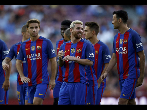 File photo: Lionel Messi (centre) along with his teammates
