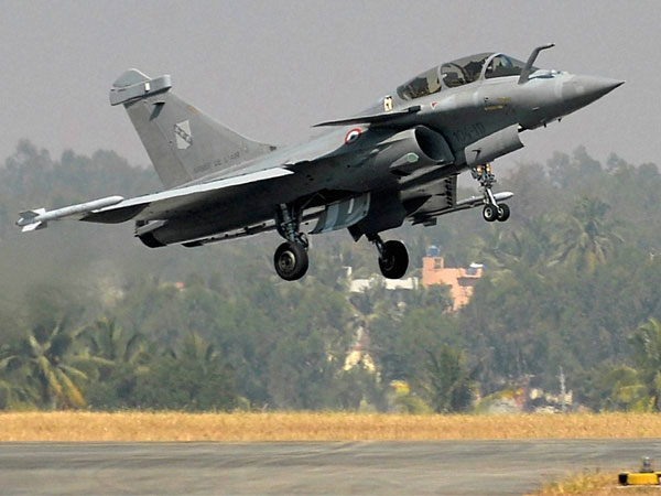 A Rafale multi-role combat aircraft from Dassault Aviation of France manoeuvres during the inauguration of the AERO INDIA