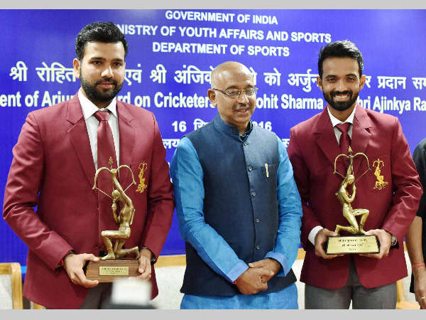 Sports Minister Vijay Goel (centre) conferred Arjuna Awards on cricketers Rohit Sharma (left) and Ajinkya Rahane for the year 2015 and 2016 respectively.