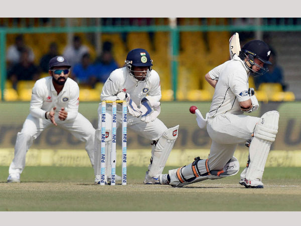 New Zealand's Tom Latham plays a shot during the 3rd Day of first test match against New Zealand at Green Park in Kanpur.