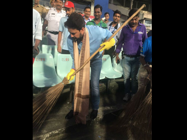 Anurag Thakur cleans the stands