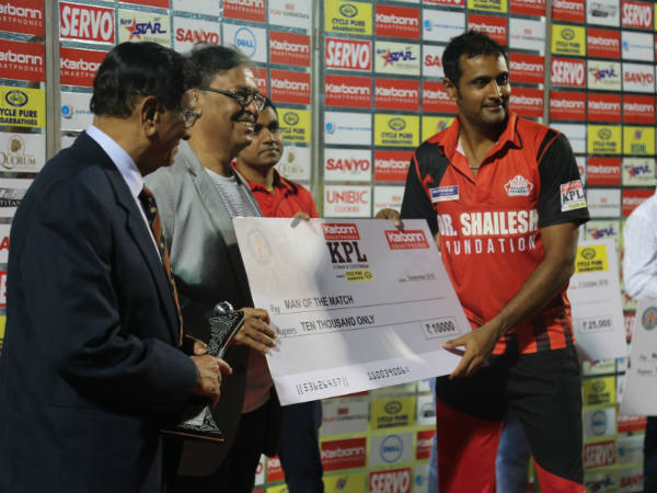 B Akhil (right) receives his Man-of-the-match award after the final
