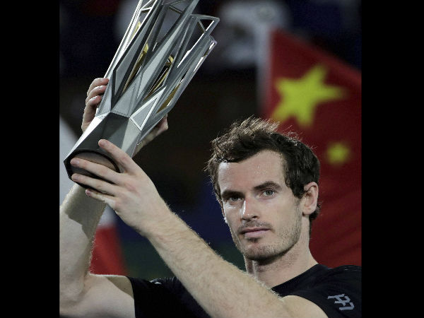 Andy Murray of Britain holds up his winner trophy after defeating Roberto Bautista Agut of Spain in the men's singles final of the Shanghai Masters tennis tournament at Qizhong Forest Sports City Tennis Center in Shanghai, China.