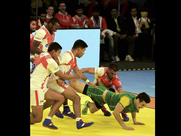 "England players try to catch Australian player during their ""Kabaddi World Cup 2016"" match in Ahmedabad on Monday."
