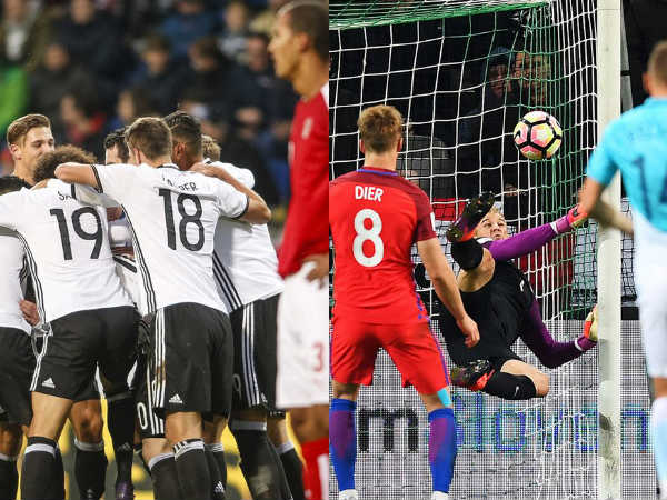 German players (left) england's Eric Dier misses penalty (Image courtesy: Germany and England Twitter handle)