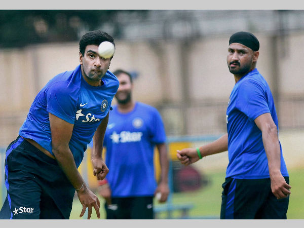 File photo: Ashwin (left) bowls at an Indian training session as Harbhajan watches
