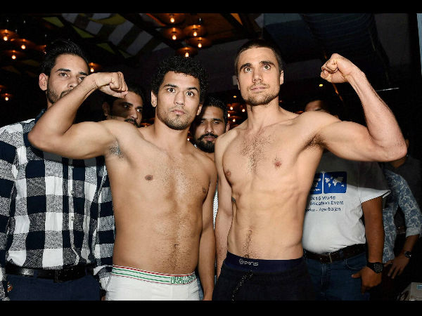 WBC Asian Wealtherweight Champion Neeraj Goyat durig a faceoff with Australian Challenger Benny Kite during a Press Conference in New Delhi on Friday to announce the title fight to be held in India on Friday.