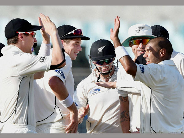 New Zealand bowler J S Patel Jubilates with his teammates after dismissed Indian batsman Ajinkya Rahane during 1st day of 2nd Test Match at Eden Garden in Kolkata on Friday.