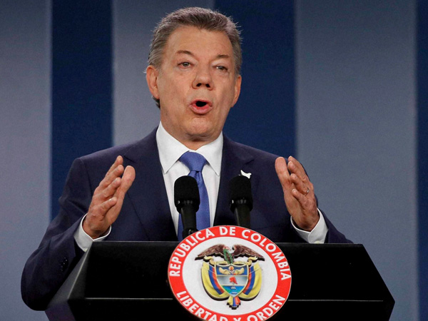 Santos to donate Nobel prize money