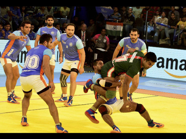 Indian players try to catch player from Bangladesh during their Kabaddi World Cup 2016 match in Ahmedabad on Tuesday.