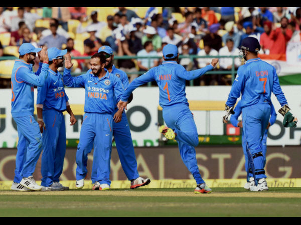 India's Kedar Jadhav celebrates with team mates the dismissal of New Zealand batsman Neesham in the first ODI match in Dharamsala on Sunday.