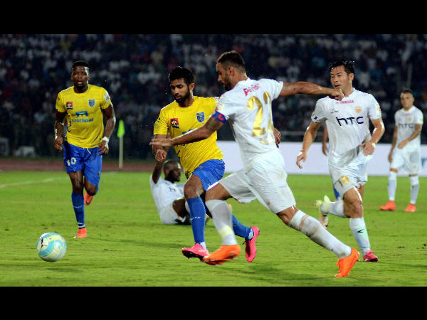 Players of Northeast United FC (in white jersey) and Kerala Blasters FC (in yellow jersey) in action during the opening match of the 3rd season of Indian Super League (ISL) 2016.
