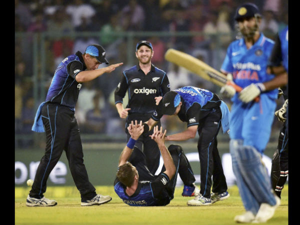 New Zealand cricketers celebrate the wicket of Indian batsman M S Dhoni during 2nd ODI