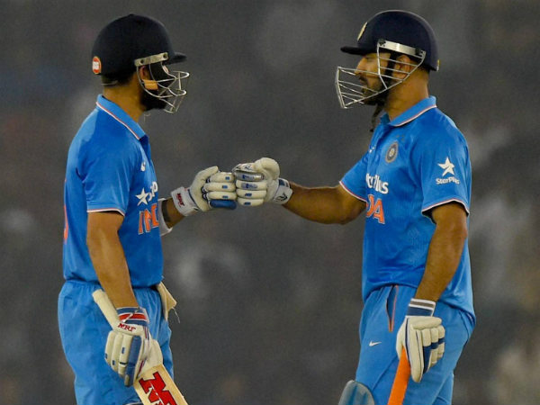 Kohli (left) and Dhoni during their partnership in the 3rd ODI in Mohali