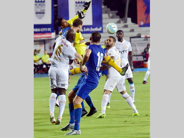 Mumbai City FC and NorthEast United FC players vie for the ball during their ISL match in Mumbai