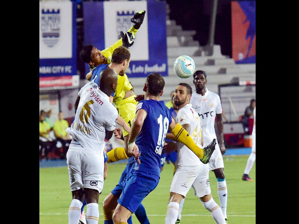 Mumbai City FC and NorthEast United FC players vie for the ball during their ISL Match in Mumbai.