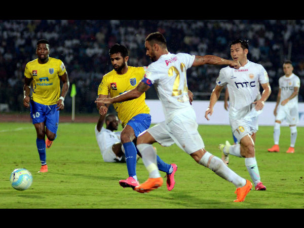 Northeast United FC (in white jersey) and Kerala Blasters FC (in yellow jersey) in action during the opening match of the 3rd season of Indian Super League (ISL) 2016, at Indira Gandhi Athletics Stadium, Sarusajai in Guwahati on Saturday.