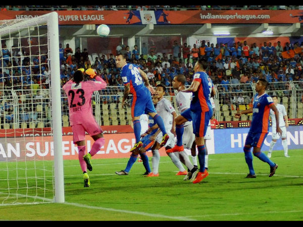 Players of FC Goa & Fc Pune City vie for the ball during their ISL match in Margao, Goa