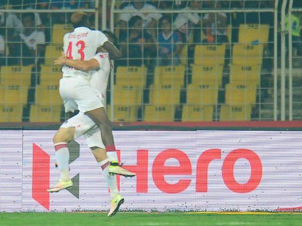 Delhi's Richard Gadze (left, 43) celebrates his goal with a team-mate