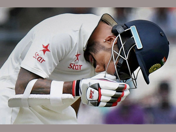 Shikhar Dhawan reacts after an injury during 3rd day of the 2nd Test match against New Zealand at Eden Garden in Kolkata on Sunday.