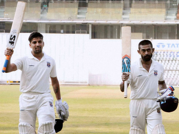 Swapnil Gugale (left) and Ankit Bawne return to the pavilion after their record partnership on Friday (October 14)