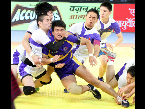 "Japanese kabaddi team player try to catch Thailand's (blue) player during ""Kabaddi World Cup 2016"" match in Ahmedabad on Wednesday."