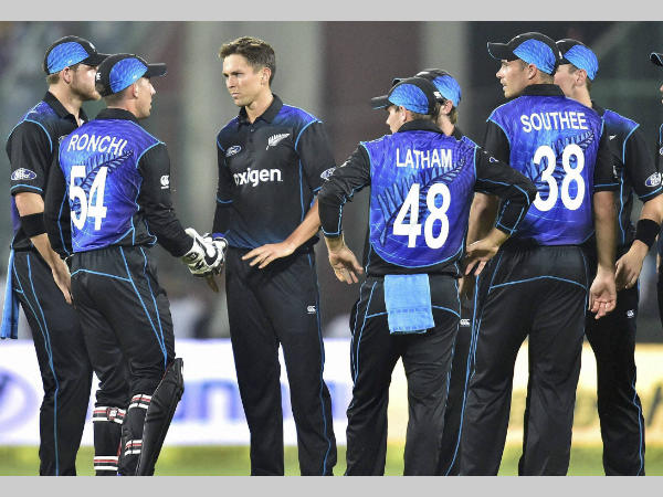 Trent Boult (3rd left) and celebrates with team-mates after dismissing Rohit Sharma (not pictured)