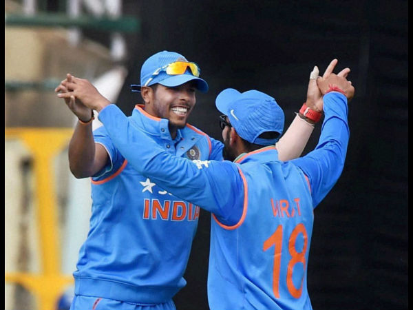India's Umesh Yadav and Virat Kohli celebrate the dismissal of New Zealand batsman C Anderson in the first ODI match in Dharamsala on Sunday.