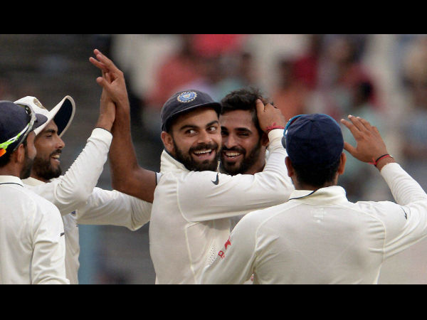 Indian players celebrate a wicket in Kolkata Test