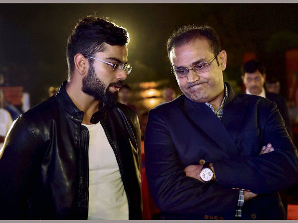 Virat Kohli and former team matevirender sehwag share a moment at the book launch of Virat Kohli's biography.
