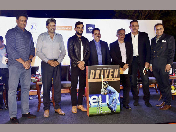Indian Test Cricket team Captain Virat Kohli with team coach Anil Kumble, former cricketers Kapil Dev,Ravi Shastri,Virender Sehwag, his coach Rajkumar Sharma, author of the book Vijay Lokapally at the book launch of Kohli's biography 'Driven' in New Delhi on Tuesday.