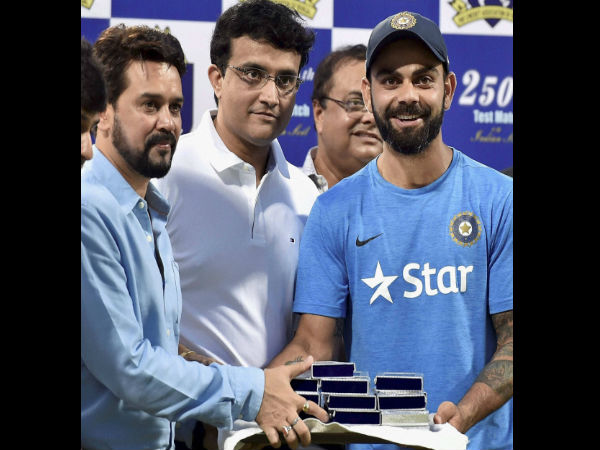 Virat Kohli receiving commemorative coins from BCCI chief Anurag Thakur