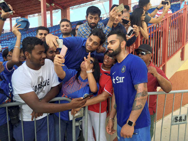 File photo: Virat Kohli poses with fans for photographs