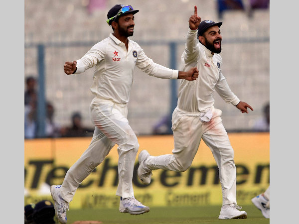 Virat Kohli (right) and Ajinkya Rahane celebrate a wicket in Kolkata Test