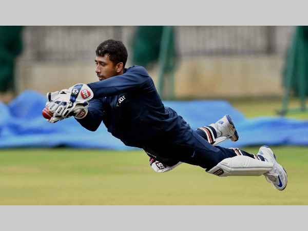 File photo: Wriddhiman Saha takes a catch during a practice session